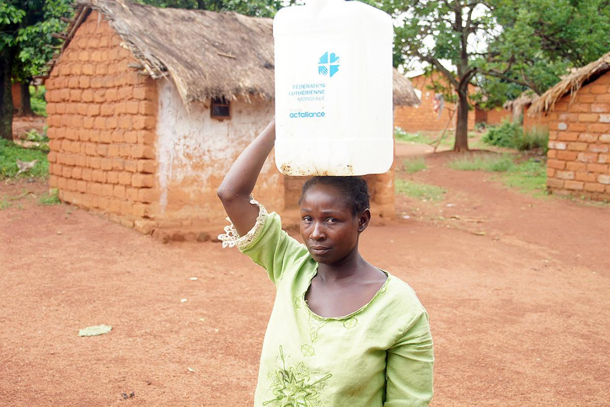 Rebecca Abbo returned to her damaged and empty house in Yongoro village, western CAR, in early May. With LWF's support, she can now access clean water. Photo: LWF/P. Mumia