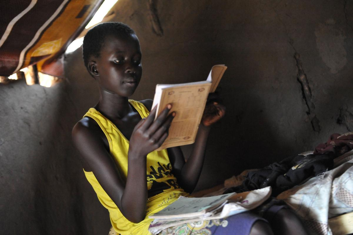 A young girl, refugee from South Sudan, studies in Adjumani, Northern Uganda. Lack of sanitation threatens the improving school enrolment for girls. Photo: LWF/ M. Renaux