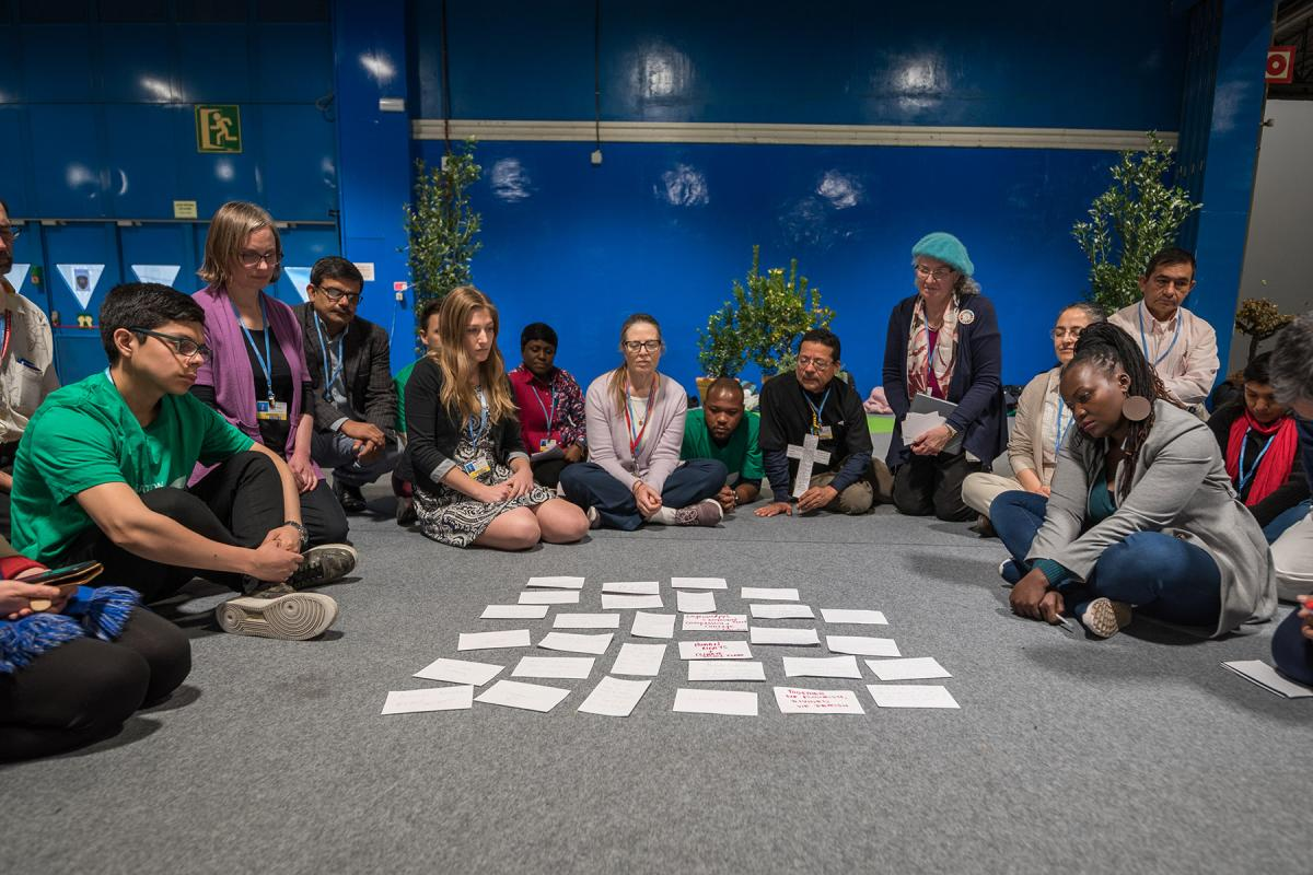 Faith-based organizations gather for a vigil, as COP25 is about to draw to a close, praying that negotiations will bear fruit, bringing about urgent and just action to find a way out of the climate crisis. Photo: LWF/Albin Hillert