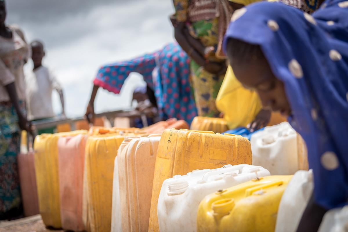 Women queue to fill up their jerry cans with drinking water at one of the tapstands in Minawao camp in the Far North region of Cameroon. The camp hosts some 58,000 refugees from North East Nigeria, and receive support from the Lutheran World Federation, together with a range of partners. All photo: LWF/Albin Hillert