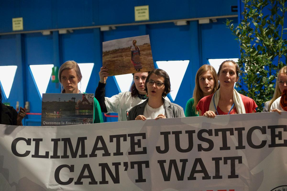 Young people urging for climate action during COP25 in Madrid, Spain. Photo: LWF/Albin Hillert