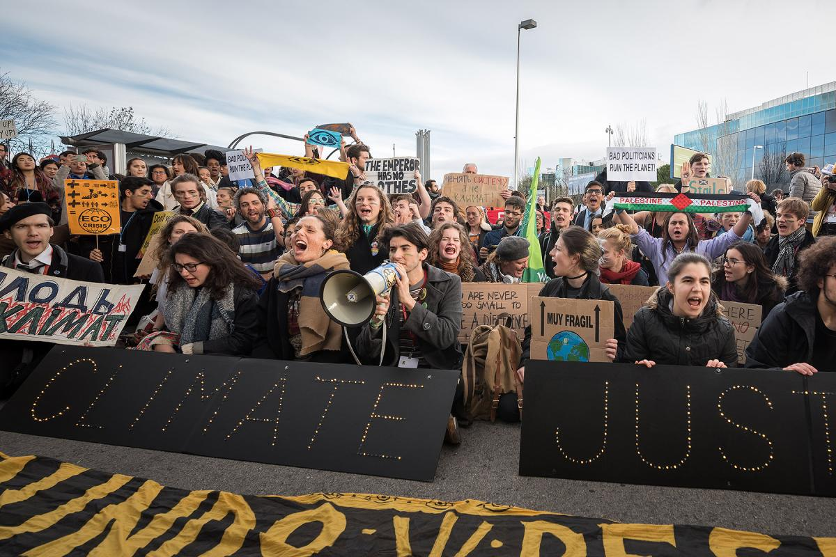 As COP25 is about to draw to a close, hundreds of young people mobilize through Fridays for Future in a strike for the climate, inside and outside the venue of COP25 in Madrid, calling for urgent action for climate justice. All photos: LWF/Albin Hillert