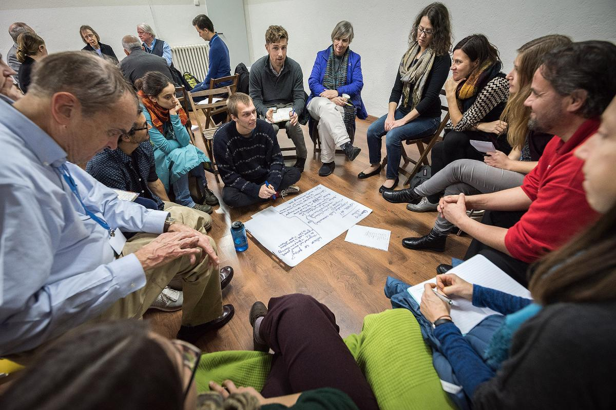 Participants gather for group discussions, zeroing in one different aspects of the impact of the climate emergency.