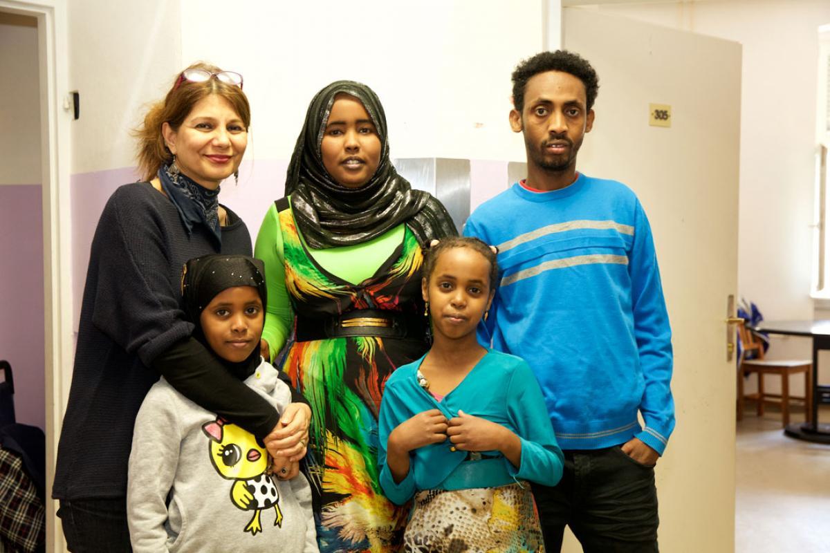 Refugee family with caretaker, left, at the refugee home Rossauer Lände, Austria. Photo: Diakonie Refugee Service Austria/ Nadja Meister