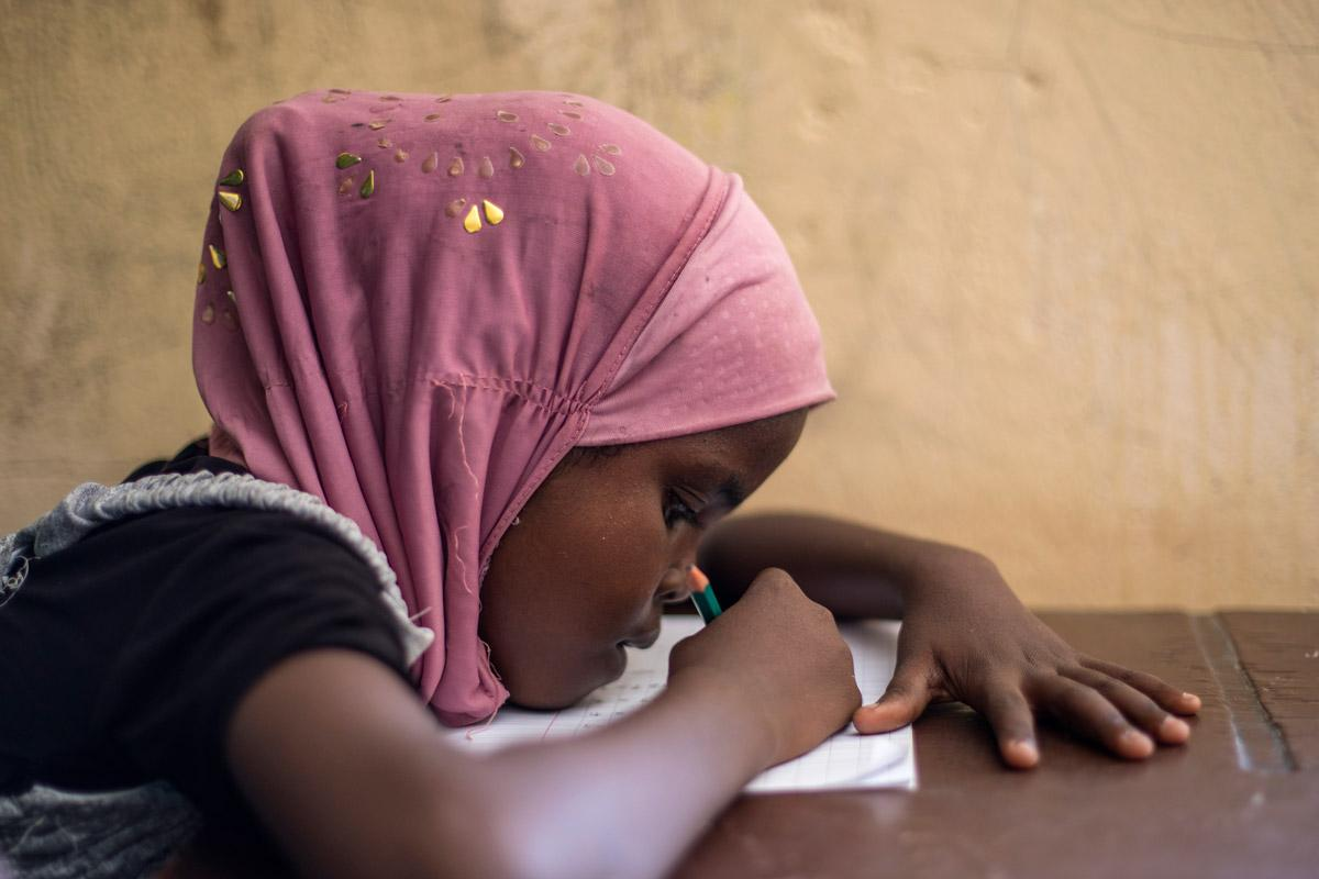 A girl from Somalia studies in an LWF primary school, Ali Addeh camp, Djibouti. LWF strongly advocated for girl's education and against early marriage. Photo: LWF/ Heléne Wikström