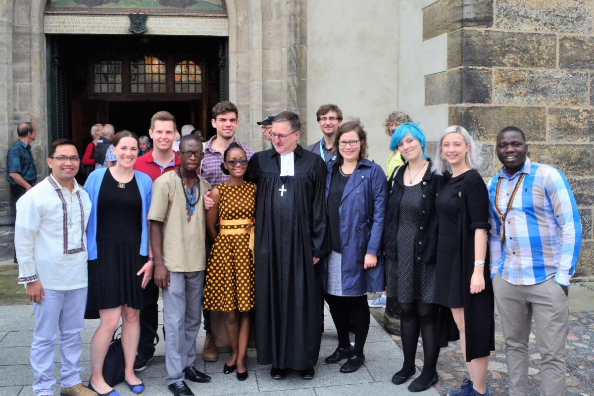 Young reformers at the door of the historic Castle Church in Wittenberg, Germany. Photo: LWF Youth/Edgar Toclo