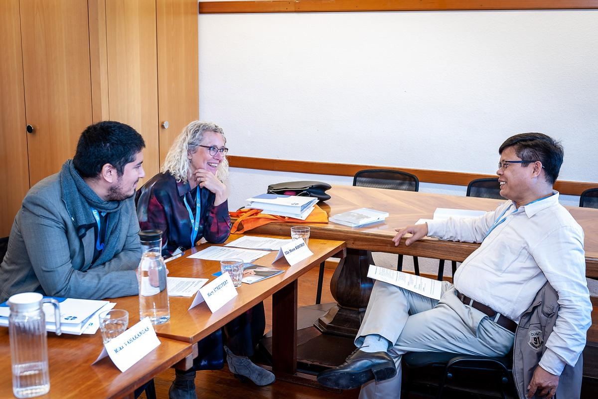 During the meeting in Geneva, Mr Diego Calquin Campos (Chile), Dr Ulla Morre Bidstrup (Denmark) and Rev. Dr Songram Basumatary (India), in a small-group discussion.  Photo: LWF/S. Gallay