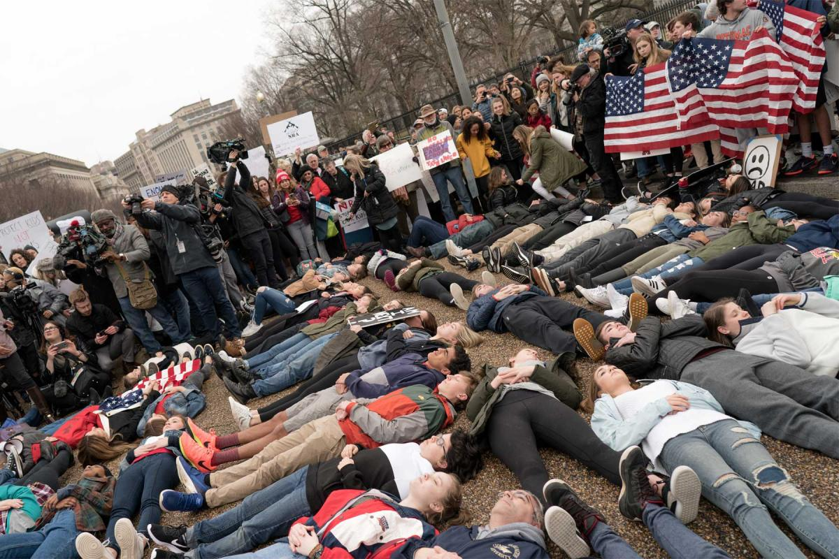 A lie-in in front of the White House, organized by students in Washington after the school shooting in Florida, calls for more legislation on privately owned firearms. Photo: Lorie Shaull/ Flickr