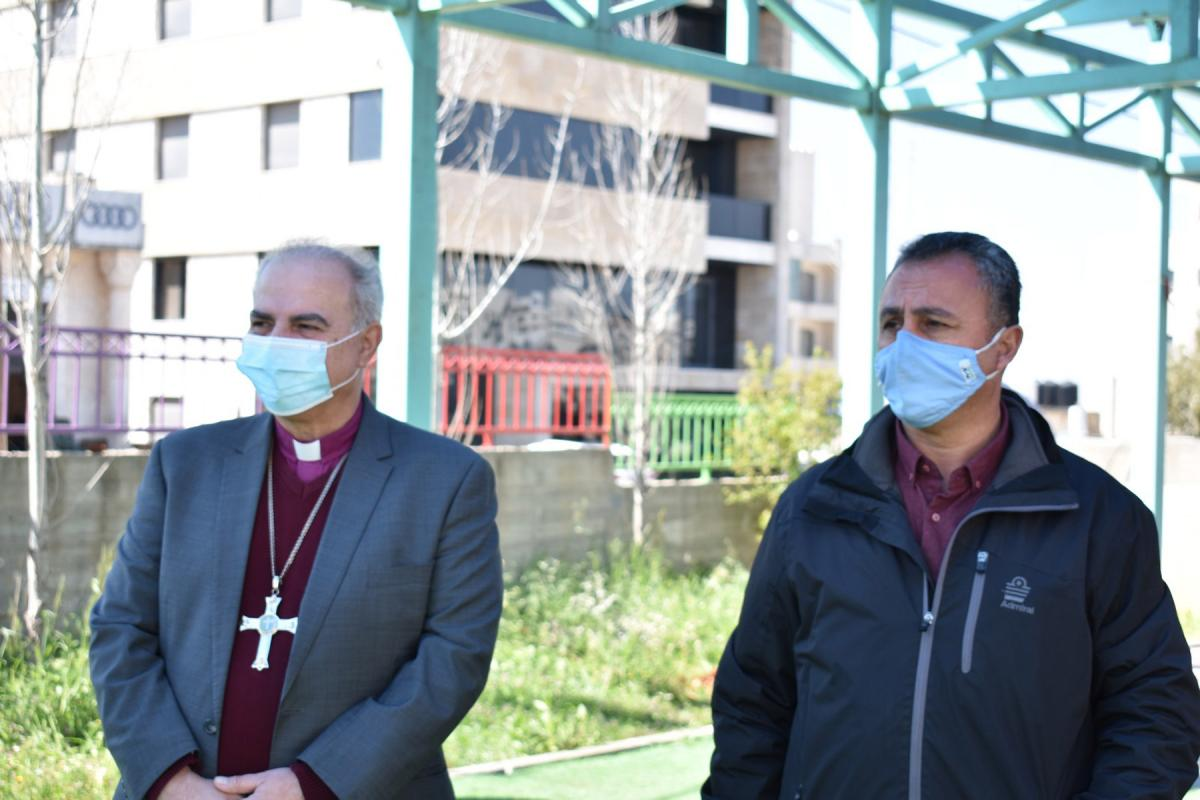 """Bishop Azar and EEC Executive Director Simon Awad plant trees in the """"Tree of Life"""" initiative for those who died from COVID-19 in Palestine. Photo: Iyad Amr/School of Hope"""