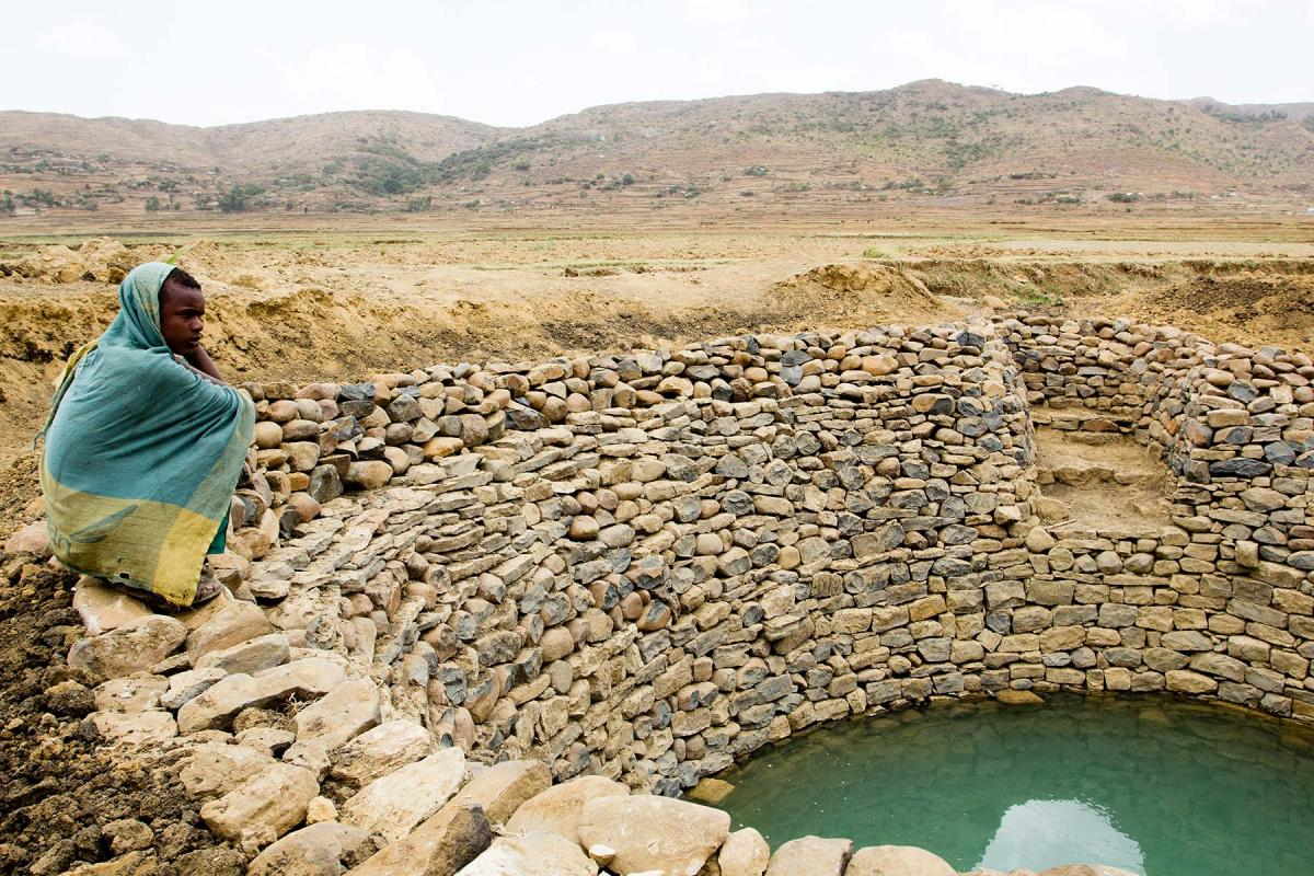 A man at a water harvesting system in Seharti Samre, Tigray. Photo: Hilina Abebe/Norwegian Church Aid (2013)