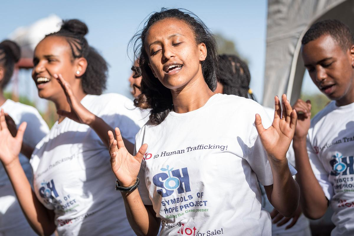 "A youth group performs at the inauguration of Bishoftu Integrated Aquaculture Vocational and Entrepreneurship Training Centre in early 2019, taking a stand against human trafficking, and the poverty that often fuels it: ""Human beings – Not for Sale!"" All photos: LWF/Albin Hillert"