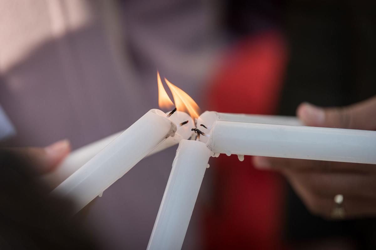 """Lighting candles together. People of faith gather in a """"Prayer for the Rainforest"""" as part of the Cumbre Social por el Clima, on the fringes of COP25 in Madrid, Spain, where faith-based organizations urged decision-makers to take action for climate justice. Photo: LWF/Albin Hillert"""