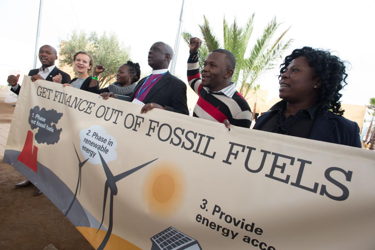 Campaign stunt symbolizing divestment from fossil fuels and support of renewable energies at COP 22 in Marrakech, Morocco in December 2016.  Photo by LWF/Ryan Roderick Beiler