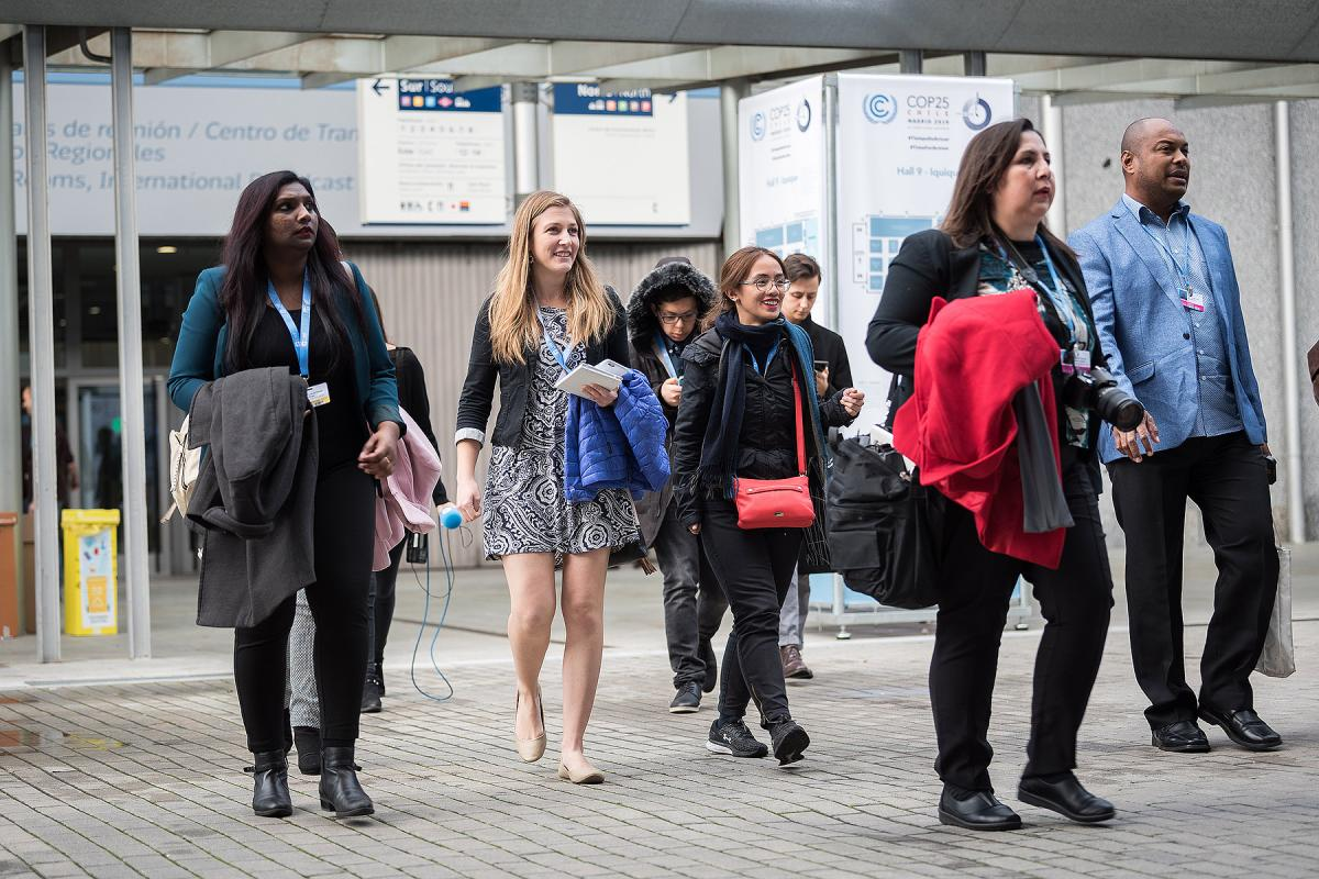 LWF Secretary for Youth Ms Pranita Biswasi (left) and other members of the LWF delegation walk toward the plenary hall on day one of COP 25 in Madrid.  LWF/Albin Hillert