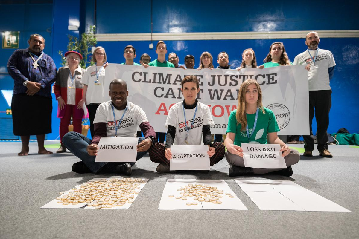 "ACT Alliance, Lutheran World Federation and World Council of Churches participants at COP25 illustrate the lack of balance in finance of the global climate response, where most of the finance is put into mitigation, some into adaptation, but very little into loss and damage, even though ""that's where the people are."" They chanted: ""What do we want? – Climate justice. When do we want it? – Now!"" Photo: LWF/Albin Hillert"