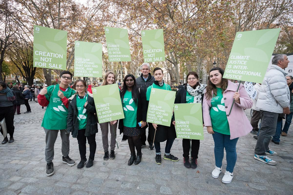 LWF delegates to COP25 taking place in Madrid, Spain, in 2019 preparing to join a march through the streets of central Madrid as part of a public contribution to the United Nations climate meeting, urging decision-makers to take action for climate justice. Photo: LWF/Albin Hillert