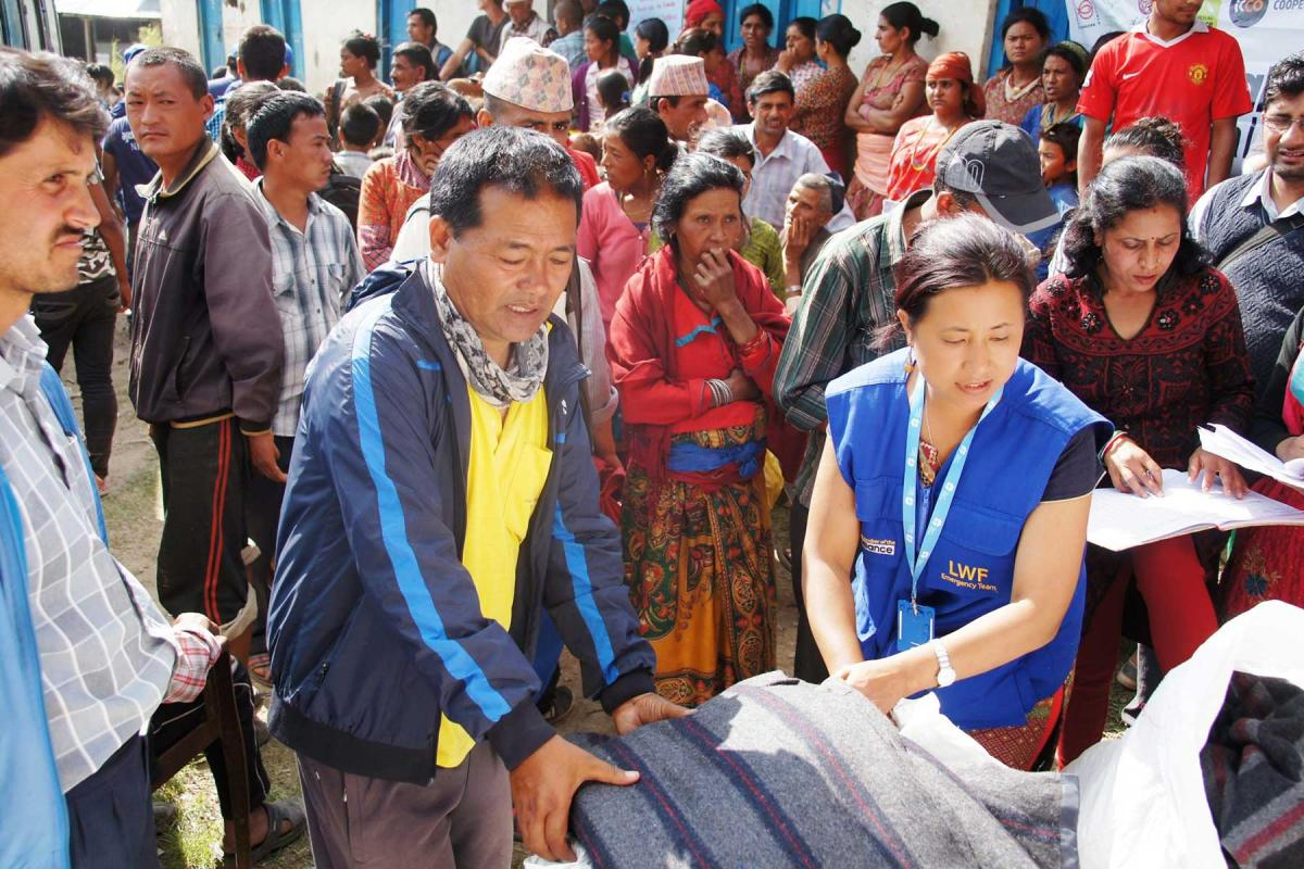 LWF Nepal staff distribute blankets and other items for emergency shelter in Nepal after the earthquake in 2015. Although many of them were affected themselves, all colleagues reported for duty and went out to support those who had lost even more. Photo: LWF/ C. Kästner
