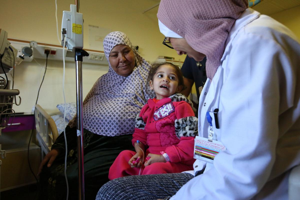 A child receiving dialysis at Augusta Victoria Hospital, East Jerusalem. The presence of a parent for treatment is one of the key demands of the LWF. Photo: Atta Jabr