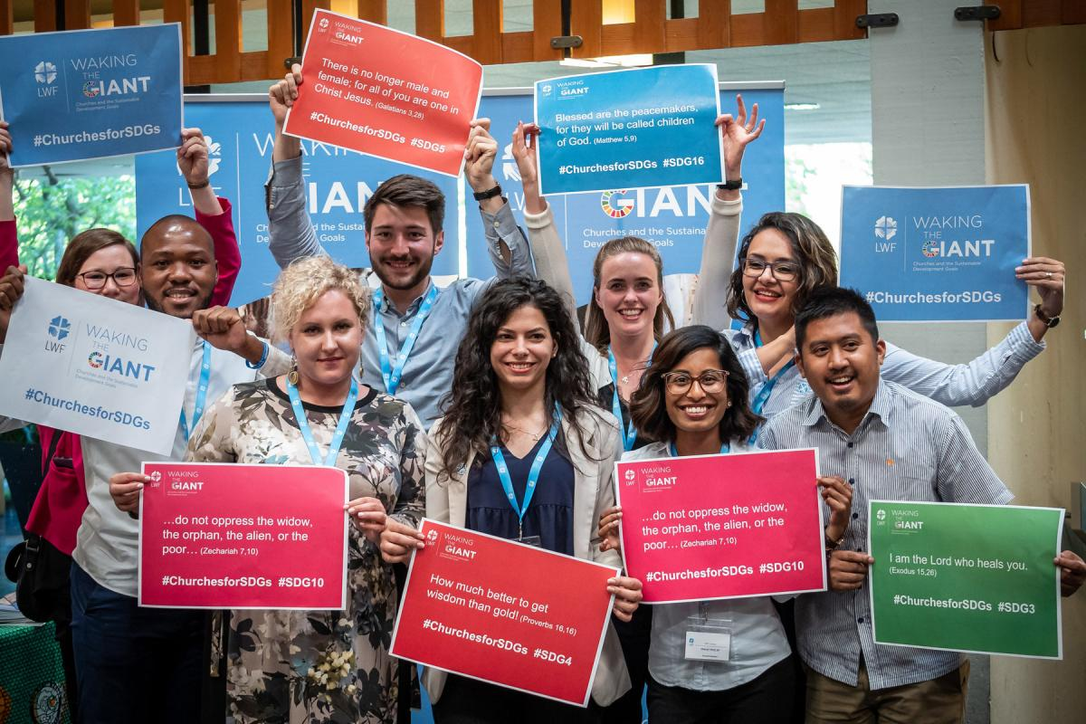 LWF Council members take part in a June 2019 event in Geneva to publicize the work of Waking the Giant. Photo: LWF/S.Gallay