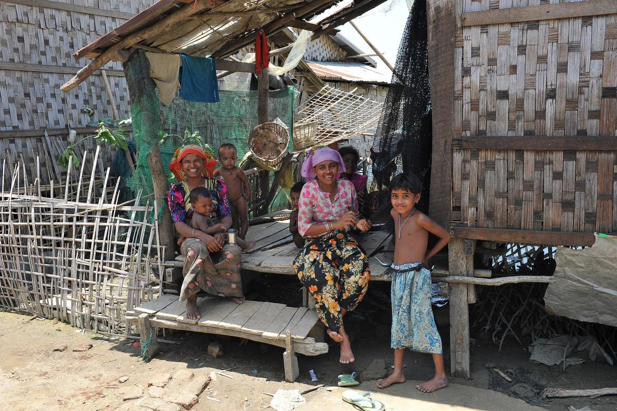 A Rohingya family in an IDP camp in Pauktaw, near Sittwe. LWF, among others, runs informal learning spaces and trains teachers to provide education for the displaced children. Photo: LWF/ C. Kästner
