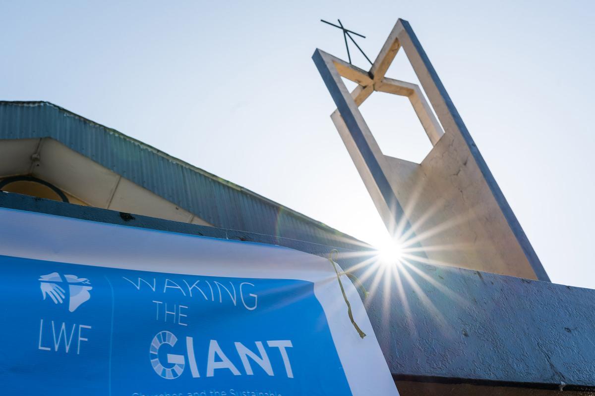 A Waking the Giant banner at Saint Peter Lutheran Church in Monrovia, Liberia. Photo: LWF/Albin Hillert
