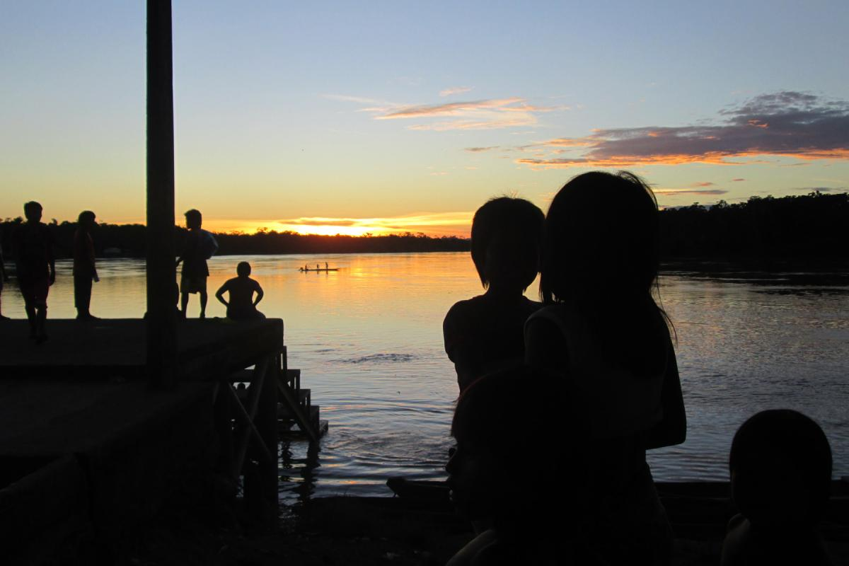 Children watch the sunrise at the Arauca river, Colombia. Photo: LWF