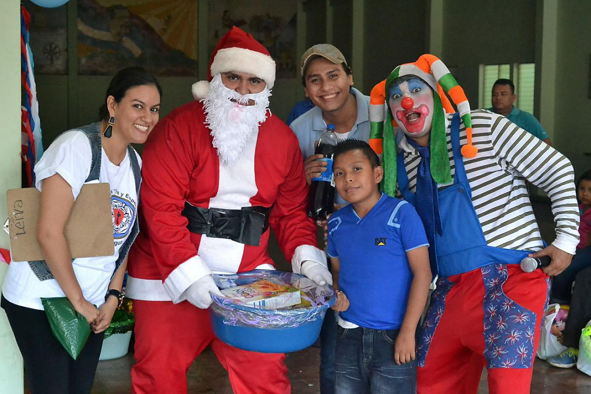 AIDS work in the Nicaraguan Lutheran Church of Faith and Hope prioritizes children. Rev. Soliette López, left, Alexander García, Kevin Mena and Sergio Rios take part in a children's Christmas party for children often  left out because of discrimination, in the western city of Masaya, near the capital Managua. Photo: Daniela Cruz