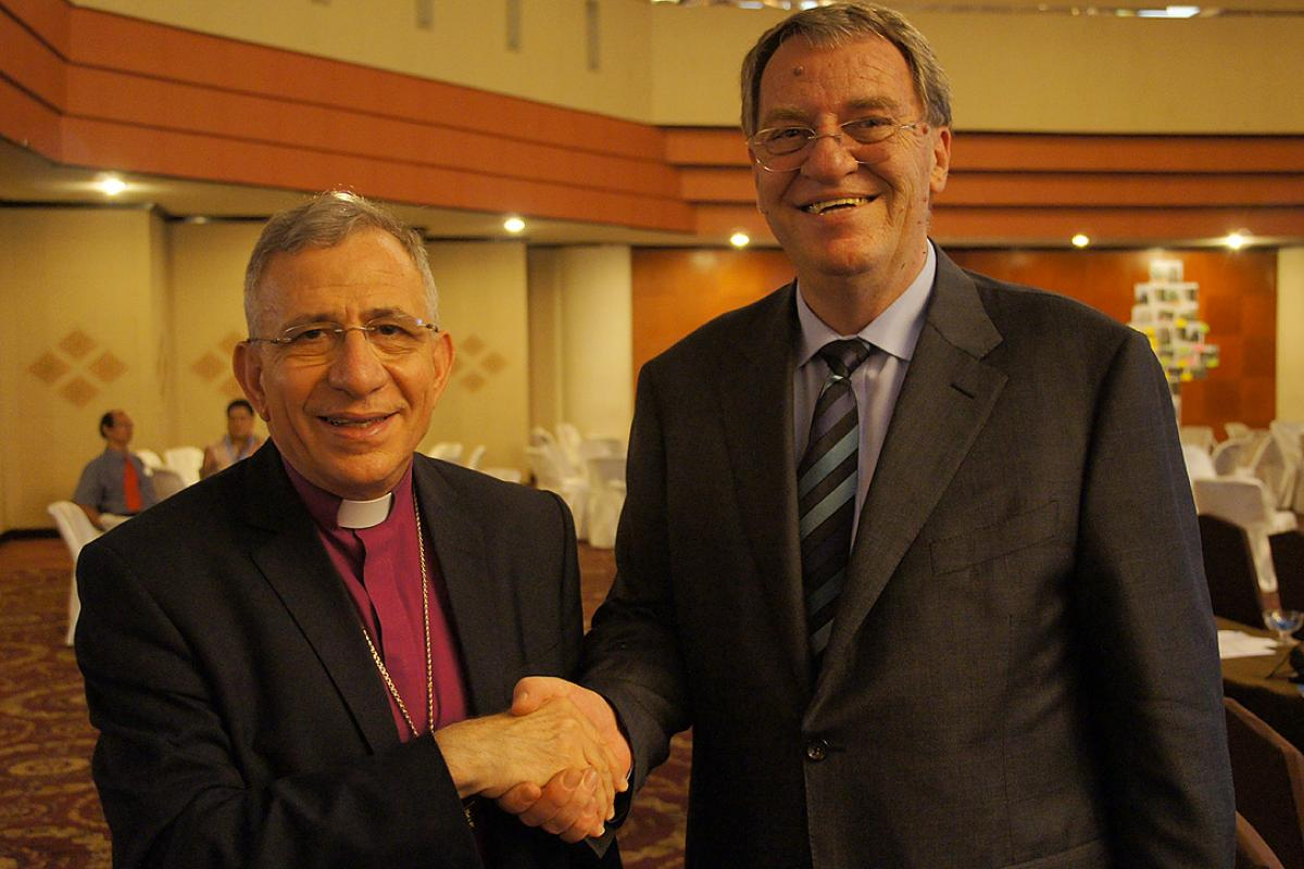 LWF President Bishop Dr. Mounib Younan thanks outgoing DWS Director Eberhard Hitzler for his dedicated service. Photo: LWF/S. Lawrence