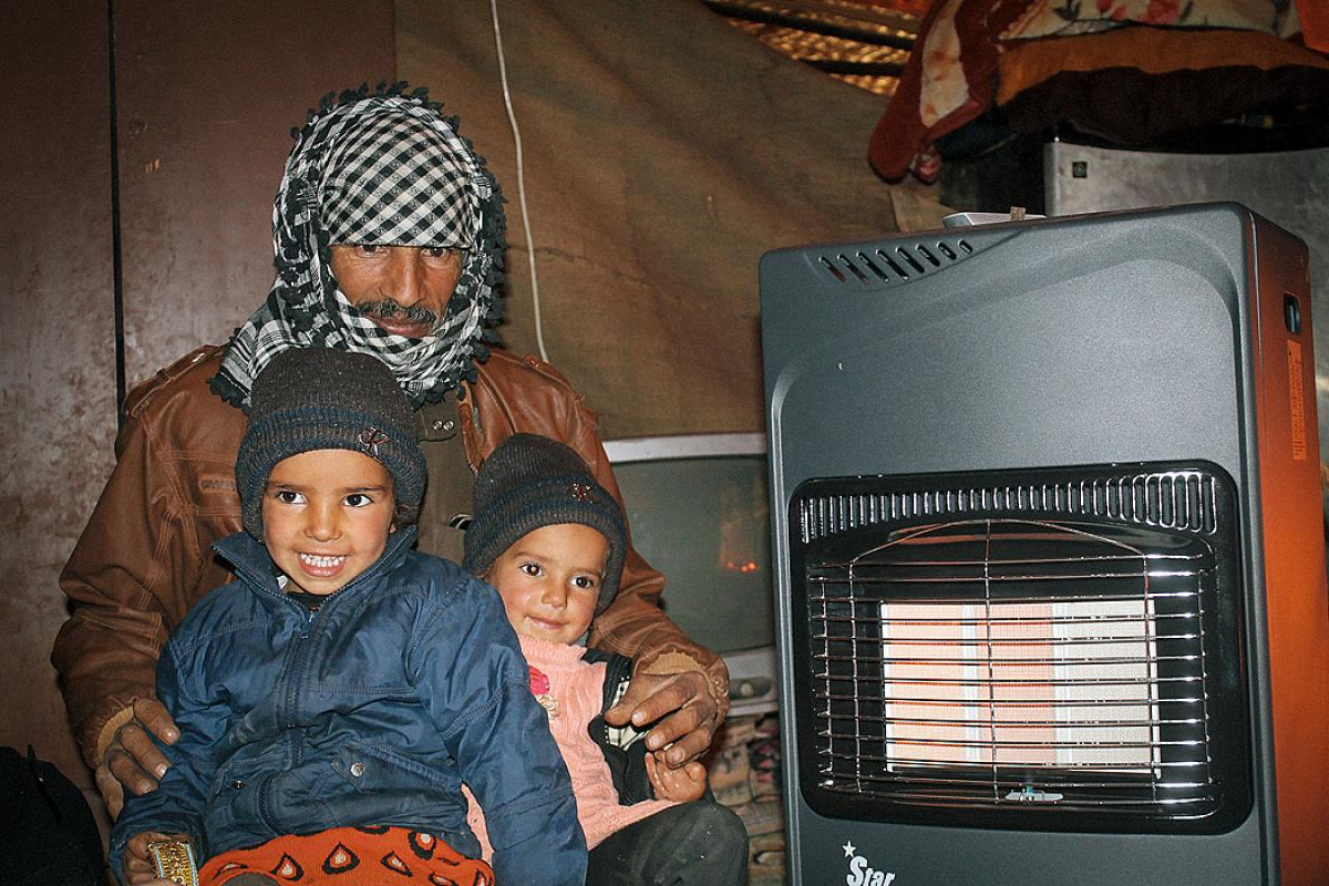 Mohammad and his two daughters in their tent. Photo: LWF/Julia Tarpy