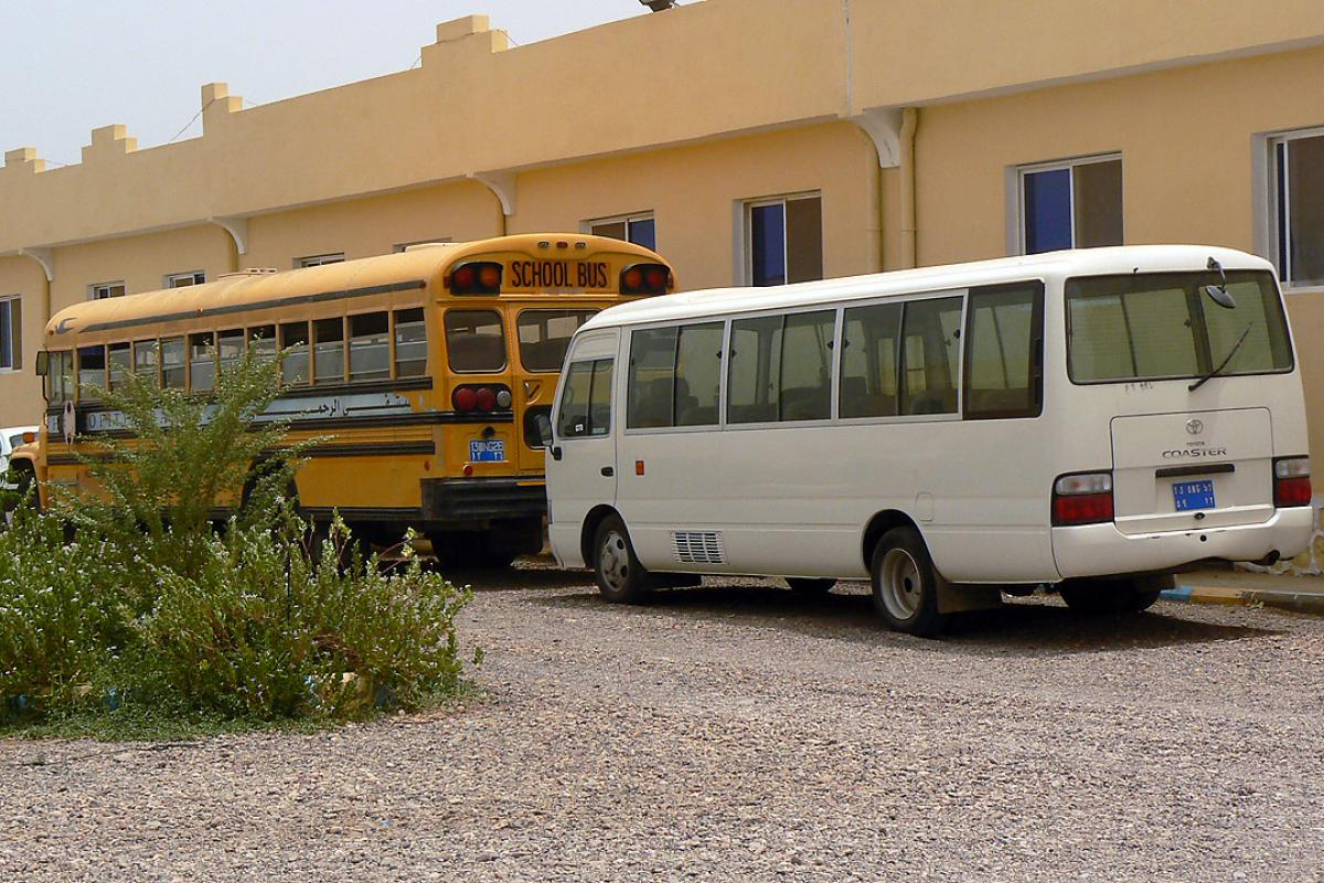 The yellow school bus in Markazi refugee camp that transports children from the refugee camp to school each day. Photo: ALWS/ Jonathan Krause