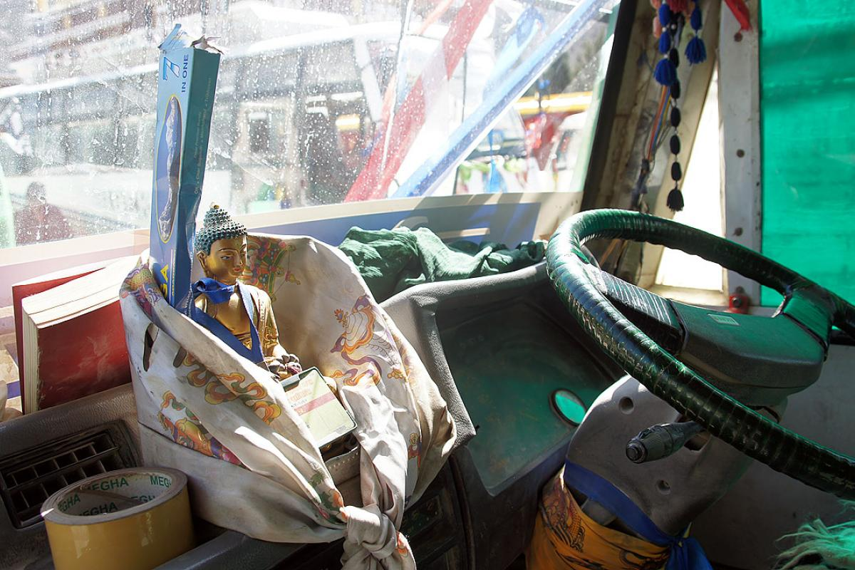 Buddha on the dashboard in a Nepali bus. Photo: LWF/ C. Kästner
