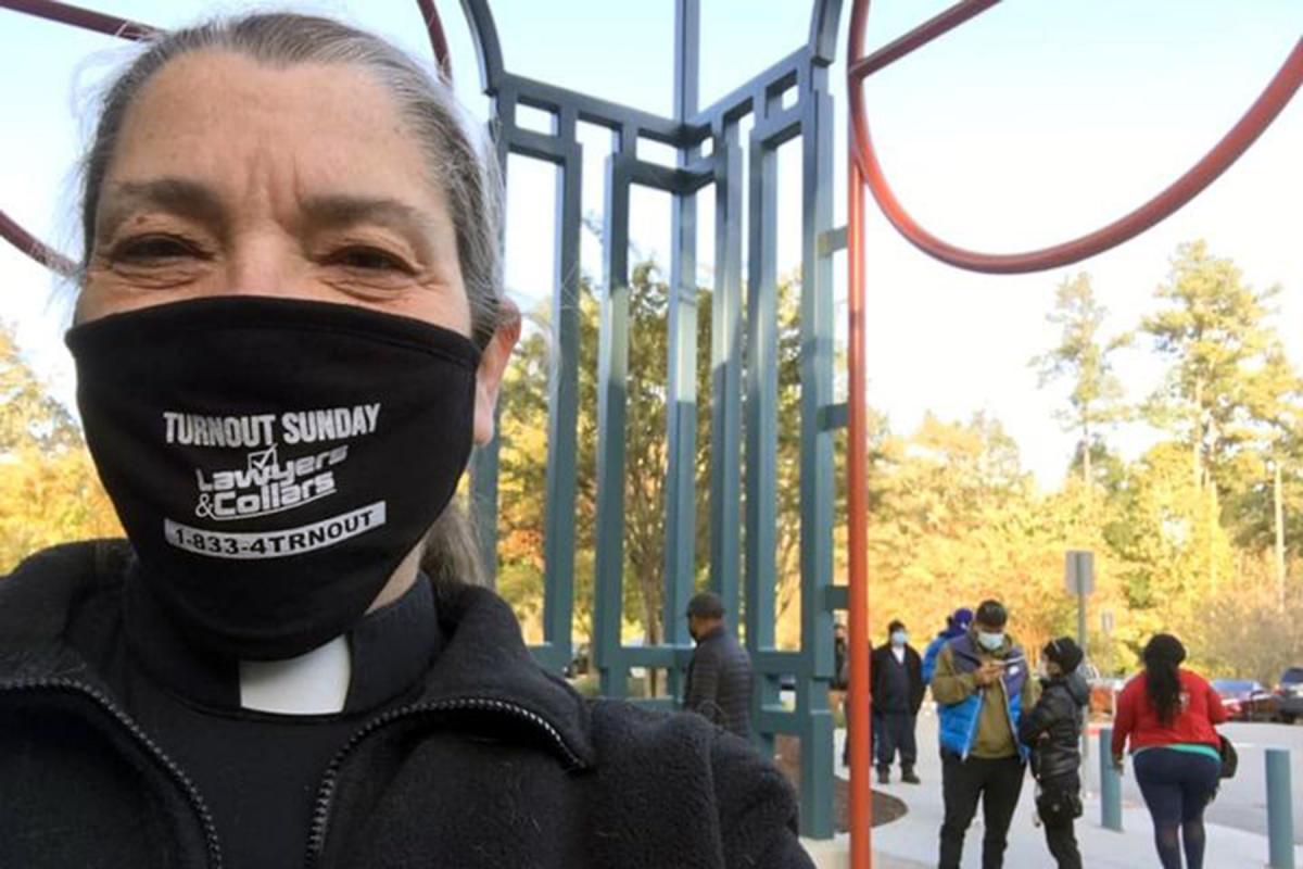 Pastor Nancy Christensen outside the Lucky Shoals Park Community Center Polling Site, Norcross, Ga. USA, on election day, 2020. Photo: Rev. Nancy Christensen
