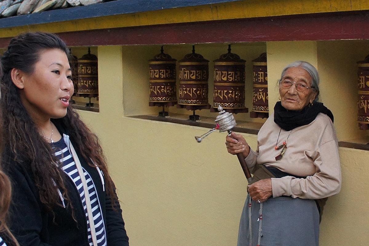 Kandho (center) and Sonam (left) in the Tishaling Tibetan Settlement, Pokhara. Photo: LWF/ C. Kästner