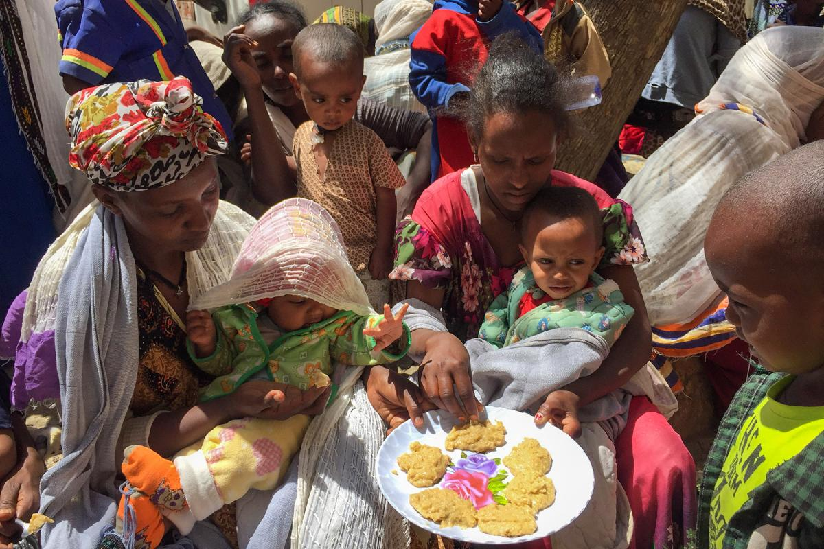 "People taste the pancakes made in a cooking distribution with the enriched ""Famix"" flour, distributed to displaced people in Tigray. All photos: LWF/ S. Gebreyes"