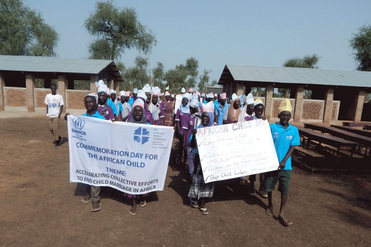 Dozens of school children march into Blue Nile Primary School protesting child marriage. Photo: LWF/J. Tiboa