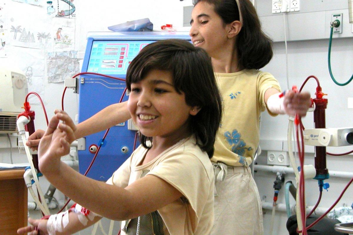 Muna & Hadiyah dancing whilst receiving dialysis treatment at Augusta Victoria Hospital two times a week. Photo: Karin Alexandra Brown