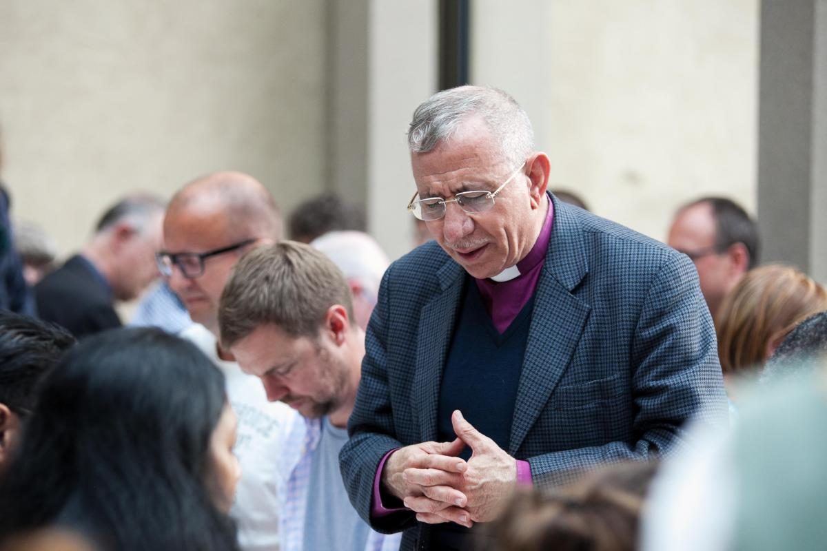 Bishop Dr. Munib Younan, President of the Lutheran World Federation, saying grace at the 2016 LWF Council in Wittenberg. Photo: LWF / Marko Schoeneberg