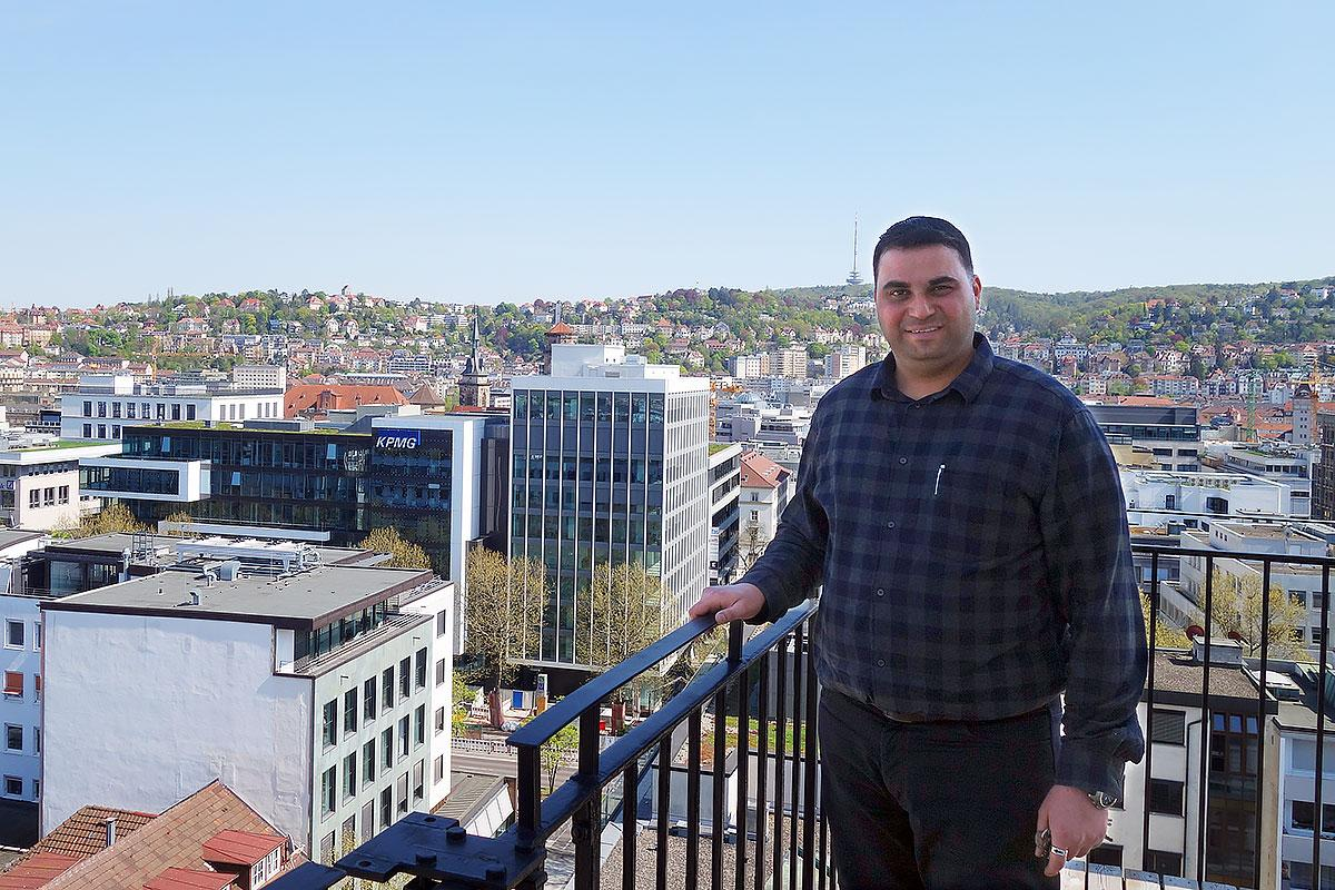 Adam Gnany, verger at the Hospitalkirche, at the roof of the church enjoying the wonderful view over Stuttgart. Photo: EMH/Ute Dilg