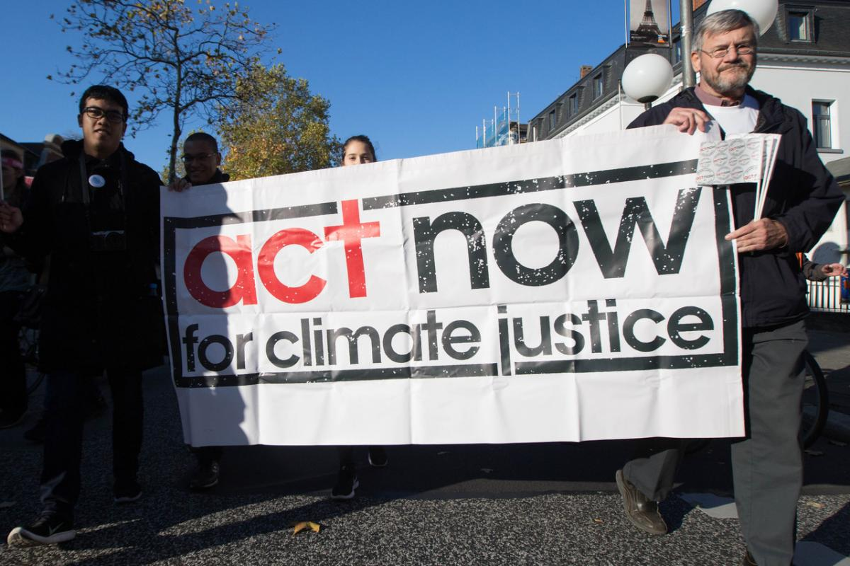 "Thousands of climate activists from across the world took to the streets of Bonn just before the start of the UN climate conference COP23. The march was called ""Fight for Climate Justice. End Coal!"" The ACT Alliance took part in the march with a banner ""act now for climate justice"". Photo: WCC/Sean Hawkey"