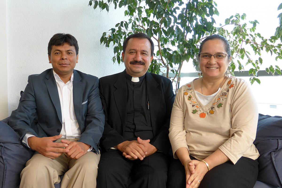 Guatemalan Lutheran church leader Rev. José Pilar Álvarez Cabrera (middle), Mr Omar Jéronimo (left) and Ms Claudia Samayoa Pineda, during the visit to Geneva. Photo: LWF/M. Haas