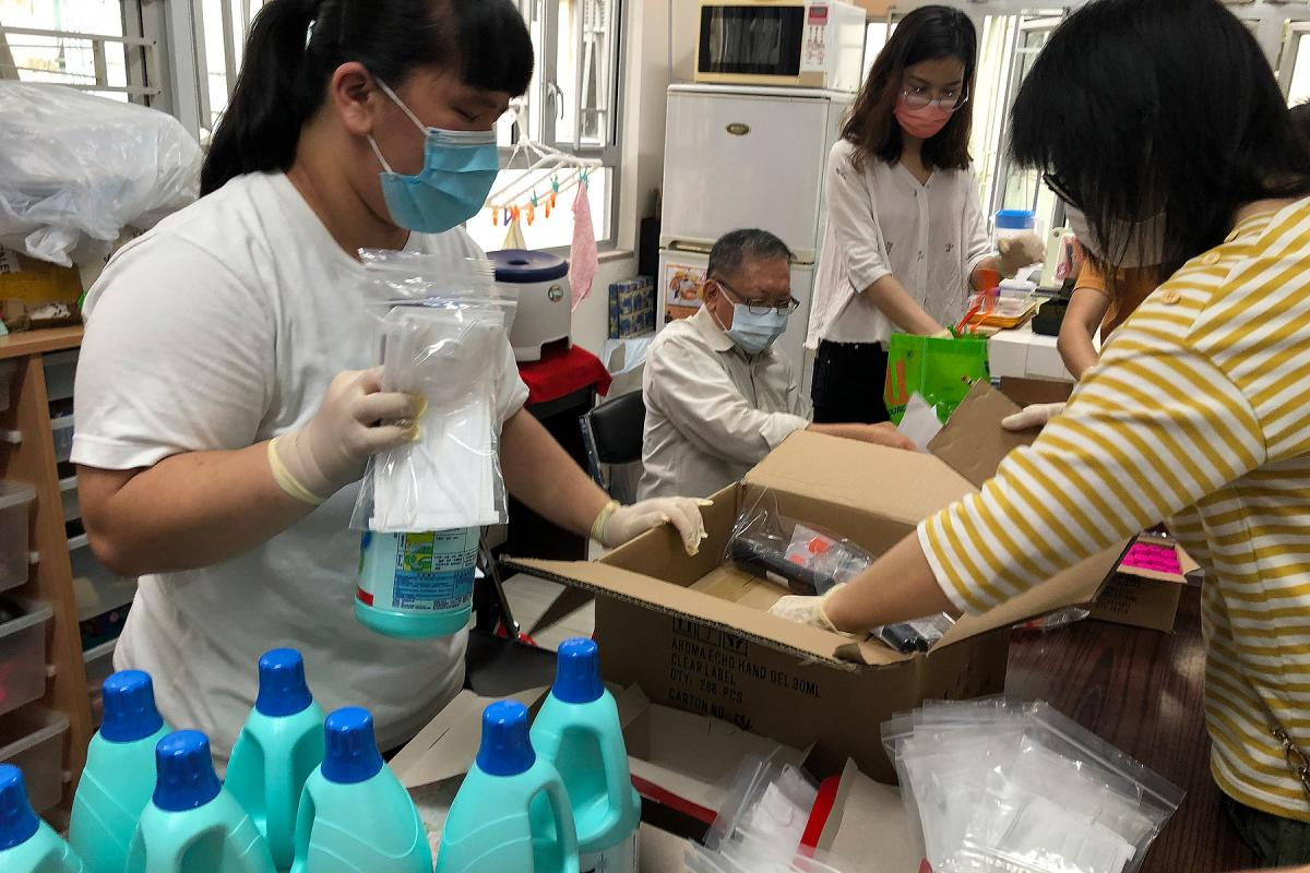 Volunteers at the Eternal Life Lutheran Church in Hong Kong prepare supplies to distribute to local people in need. All Photos: ELCHK