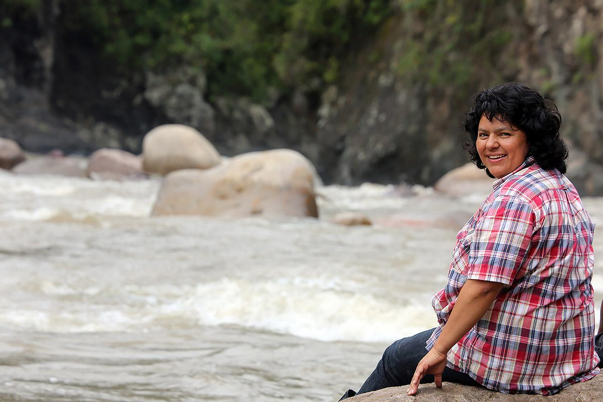 Berta Caceres stands at the Gualcarque River in the Rio Blanco region of western Honduras where she, COPINH (the Council of Popular and Indigenous Organizations of Honduras) and the people of Rio Blanco have maintained a two year struggle to halt construction on the Agua Zarca Hydroelectric project, that poses grave threats to local environment, river and indigenous Lenca people from the region. Photo: Tim Russo/Goldman Environmental Prize