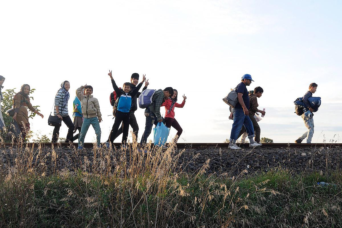 Refugees walking on the railways at the border between Hungary and Serbia. Photo: ELCH/ Zsuzsanna Horvath-Bolla