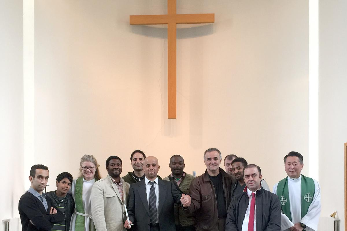 Rev. Toshiki Toma (right) and Rev. Kristín Þórunn Tómasdóttir (third from left) with the congregation at Laugarnes-church in Reykjavik. Photo: Rev. Hjalti Jón Sverrisson