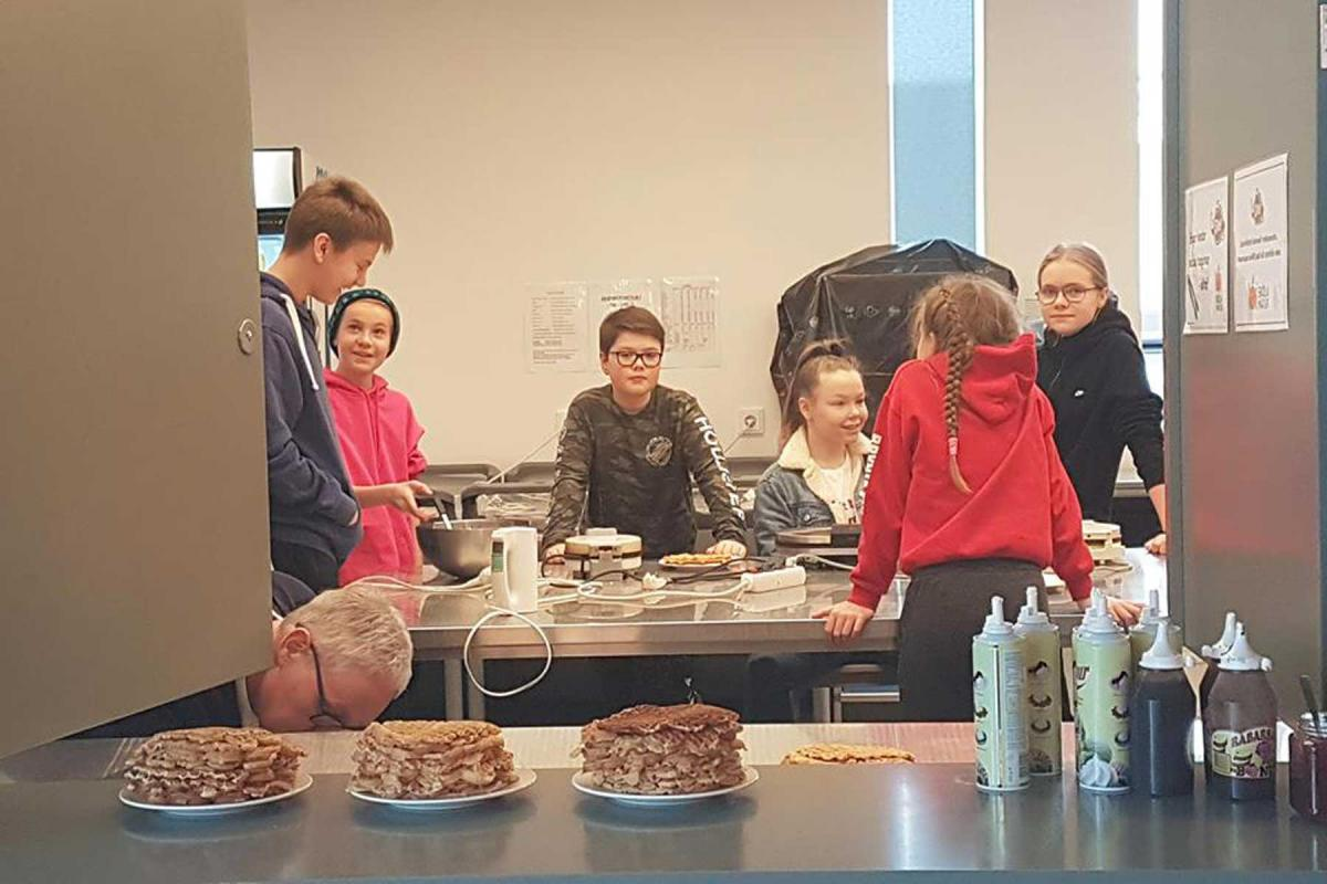 Selling waffles, a favorite dish, after worship was one way to raise to money for children in Uganda. Photo: Stefan Mar Gunnlaugsson / The Evangelical Church of Iceland