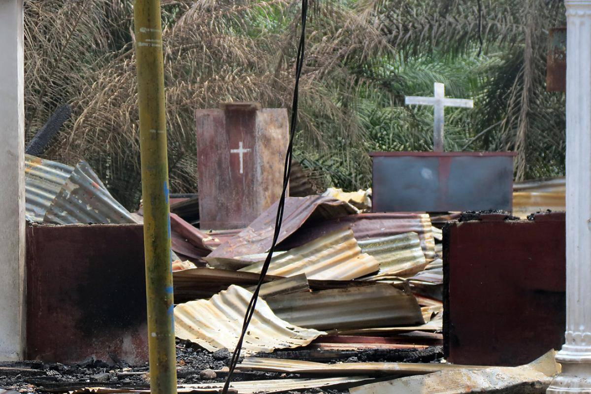 Two crucifixes remain upright in the remnants of an Indonesian church burned in October 2015. Photo: LWF Indonesia