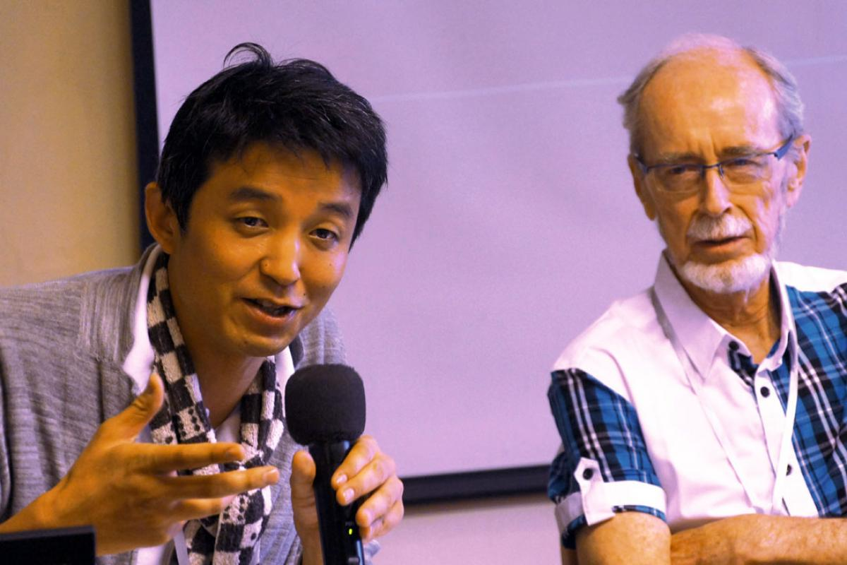 Japanese theologian Rev. Dr Arata Miyamoto speaks at the interfaith consultation where Pof. Notto R. Thelle from Norway (right) encouraged openness to the wisdom and experiences of other religions. Photo: LWF/I. Benesch