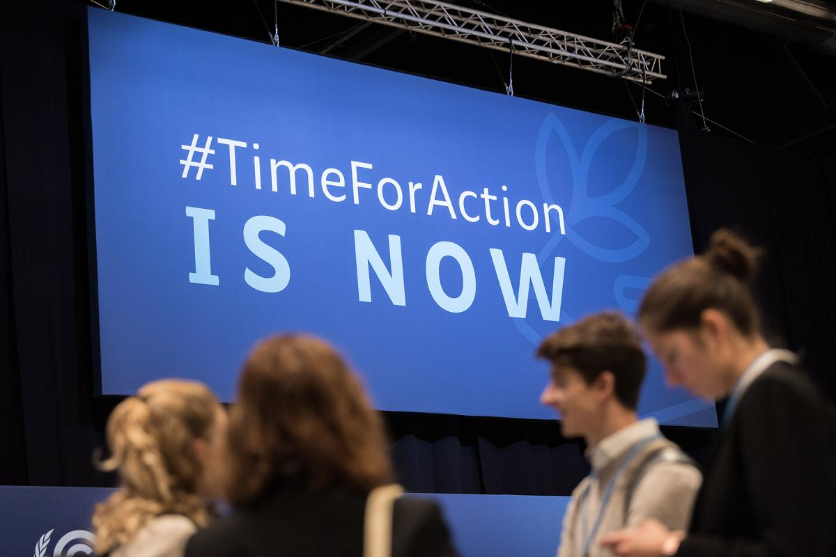 A sign board during the COP25 opening plenaries in Madrid in December 2019. Photo: LWF/Albin Hillert