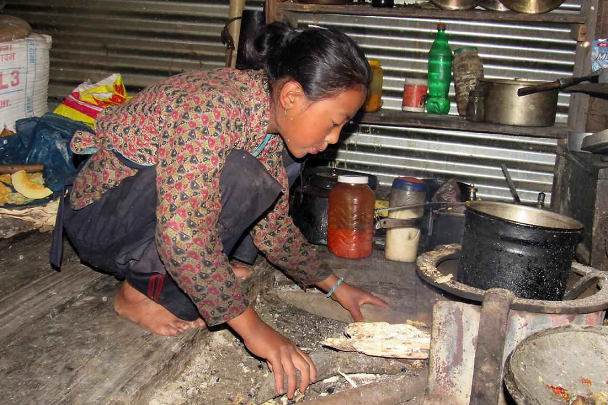 Nima Chhiyog Lama, 13, a seventh grader in Gatlang prepares food and takes care of her siblings before school. Surviving the earthquake is like being given a second life, she says. Photo: LWF Nepal