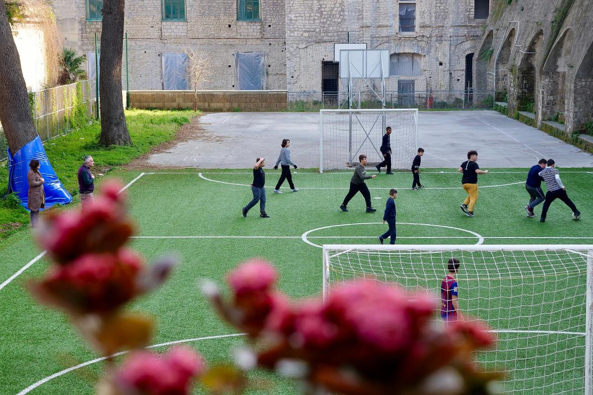 Children from the Quartieri Spagnoli area of Naples enjoy football training as part of an education project to help them learn vital life skills Photo: Caroline von der Tann/ELCI